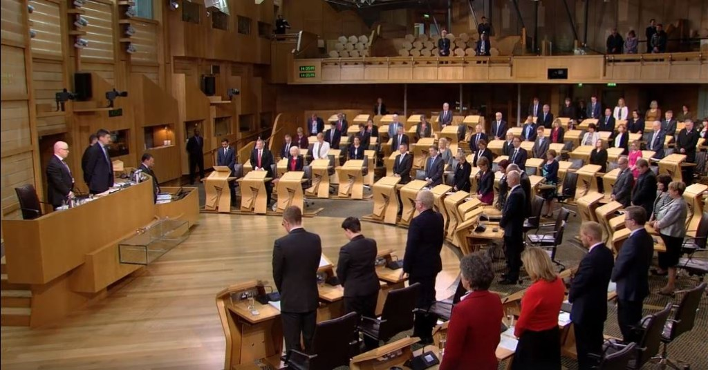 MSPs take part in a minute silence following the Orlando shootings