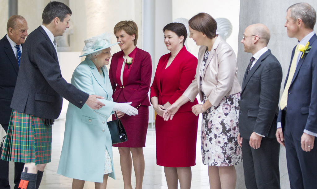 Her Majesty Queen Elizabeth II meets with party leaders at the Opening of the Scottish Parliament. The Queen is escorted by Presiding Office Ken MacIntosh and meets First Minister Nicola Sturgeon, Scottish Conservative leader Ruth Davidson, Scottish Labour leader Kezia Dugdale, Scottish Green leader Patrick Harvie, and Scottish Liberal Democrat leader Willie Rennie. June 2 2016.