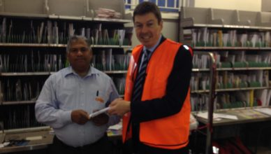 Ken with local postie, Mathai Varghese